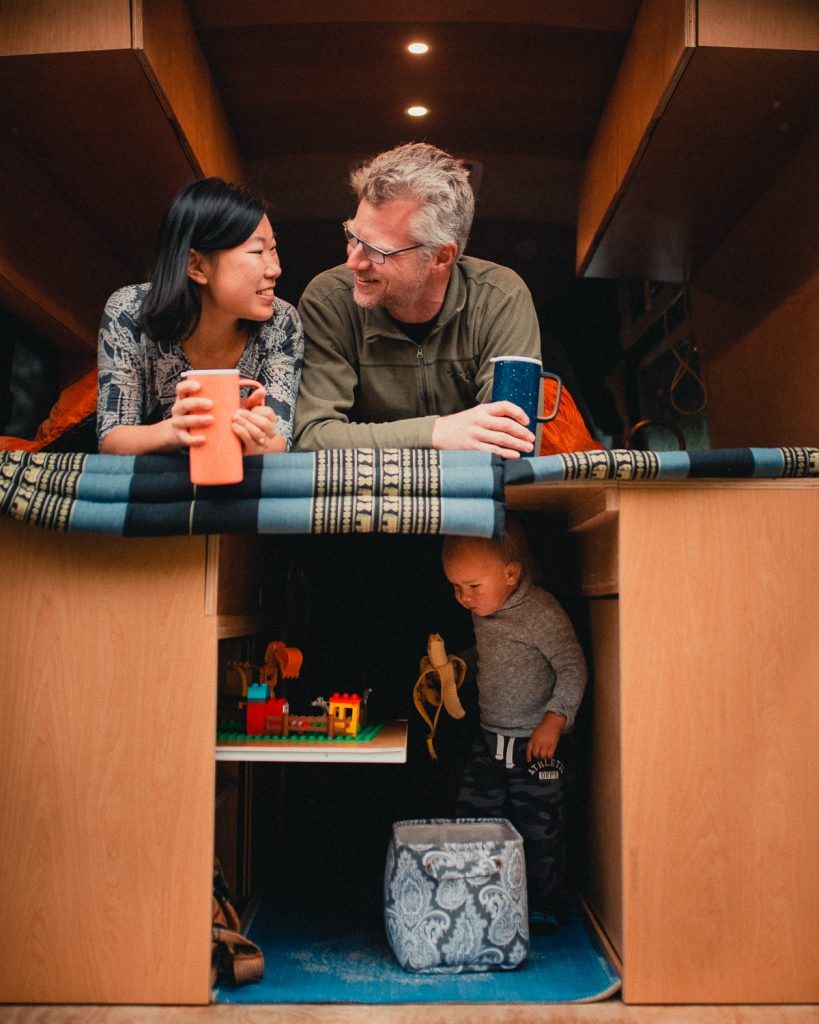A family living a vanlife with their kid and cat