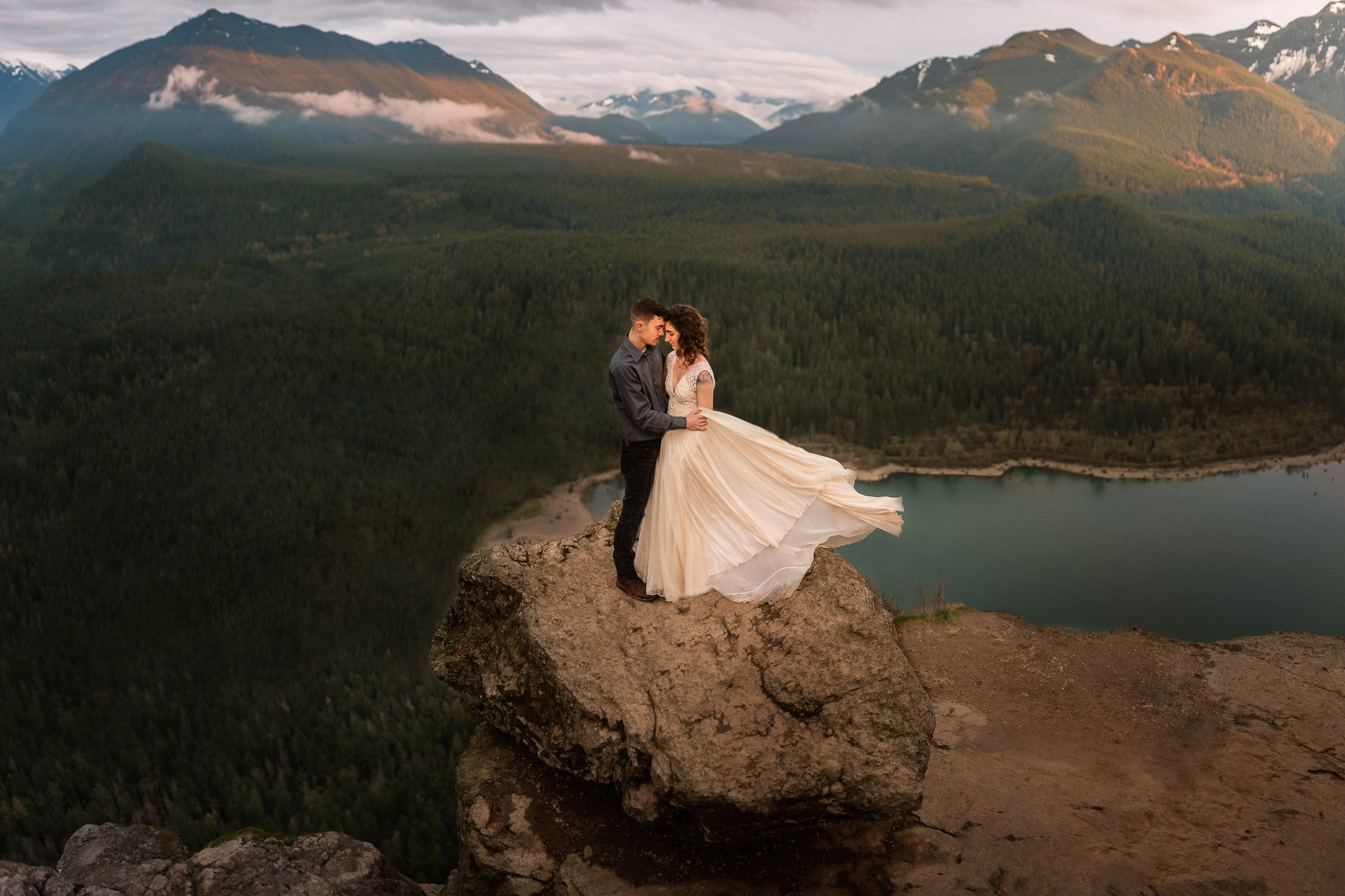 Couple hugging on mountain over lake in Vancouver