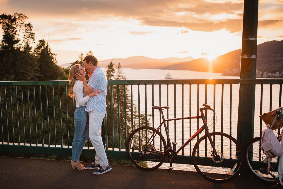 Couple kissing on lions gate bridge