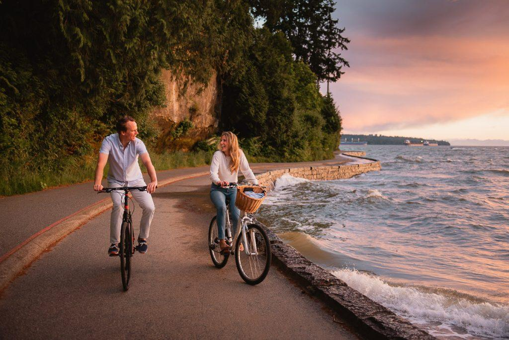 Couple biking on seawall in Stanley Park Vancouver engagement photography