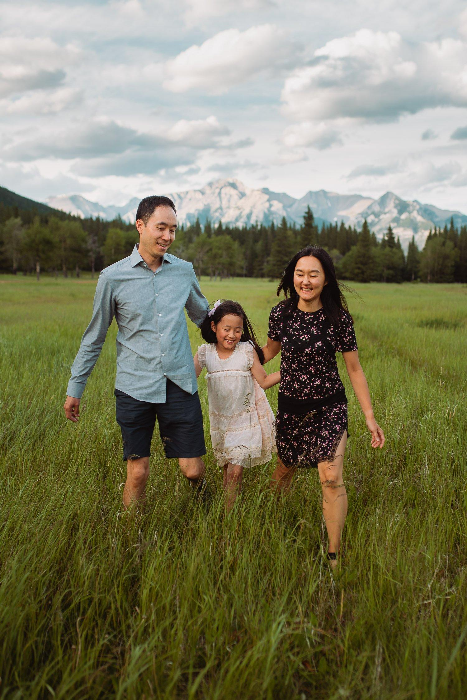 family walking in field vancouver photographer